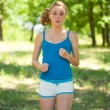 Sporty blonde girl doing fitness outdoor - Stock Photo
