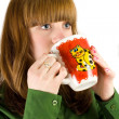 Girl drinking from a cup — Stock Photo #2214428