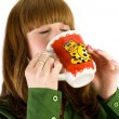 Girl drinking from a cup — Stock Photo