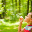 Cute kid blowing soap bubbles — Stock Photo #2214519