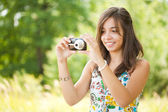 Young lady taking photos outdoors — Stock Photo