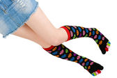 Gambe con calze colorate — Foto Stock
