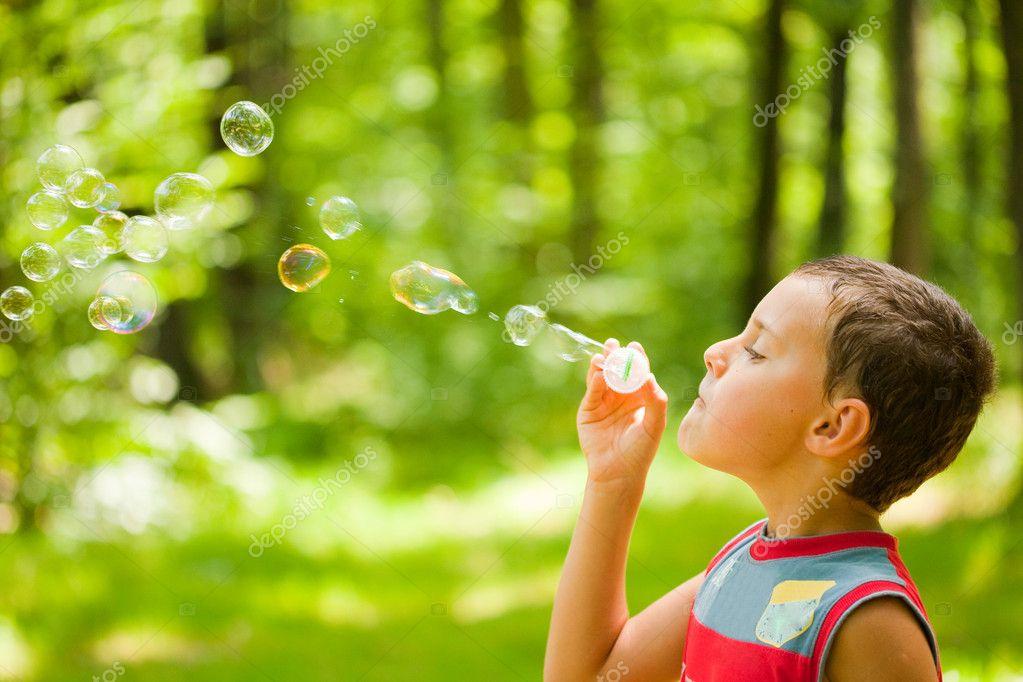Kid Blowing Soap Bubbles Cute Kid Blowing Bubbles