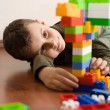Cute kid playing with cubes - Stock Photo