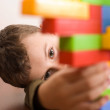 Cute kid playing with cubes — Stock Photo #2243520