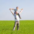 Father and son in a wheat field — Stock Photo