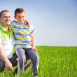 Father and son having good time outdoor — Stock Photo