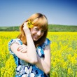 Blonde in a rape field — Stock Photo #2243992