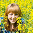 Blonde in a rape field — Stock Photo #2244018
