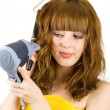 Stock Photo: Blonde girl using hair drier