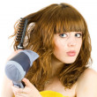 Blonde girl using hair drier — Stock Photo #2244386