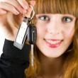 Sales woman offering car keys — Stock Photo