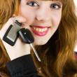 Sales woman offering car keys — Stock Photo #2244459