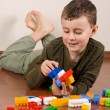 Cute kid playing with cubes — Stock fotografie