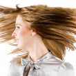 Beautiful blonde flipping hair — Stock Photo