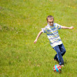 Boy playing football — Foto Stock