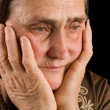 Old woman in sadness — Stock Photo