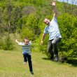 Stock Photo: Father and son having good time together