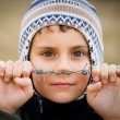 Boy behind barbed wire — Stock Photo