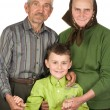 Happy elderly couple with their grandson — Stock Photo