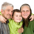Stock Photo: Happy elderly couple with their grandson