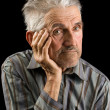Old man on black background - Stock Photo