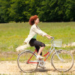 Woman with bike — Stok fotoğraf