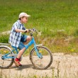 Stock Photo: Boy with bike