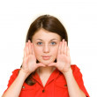 Woman framing her face with her palms — Stock Photo #2249994