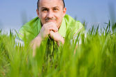 Man in a wheat field — Stock Photo
