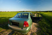 Car on a country side road — Stock Photo