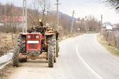 Tractor and trailer with logs — Stock Photo