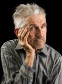 Old man on black background — Stock Photo