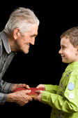 Grandson and grandfather — Stock Photo
