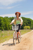 Woman with bike — Stock Photo