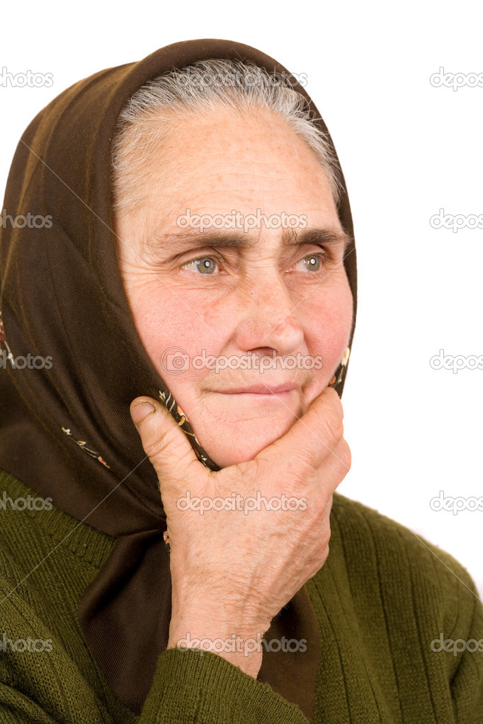 Close-up portrait of an old peasant woman isolated on white background  Stock Photo #2245065