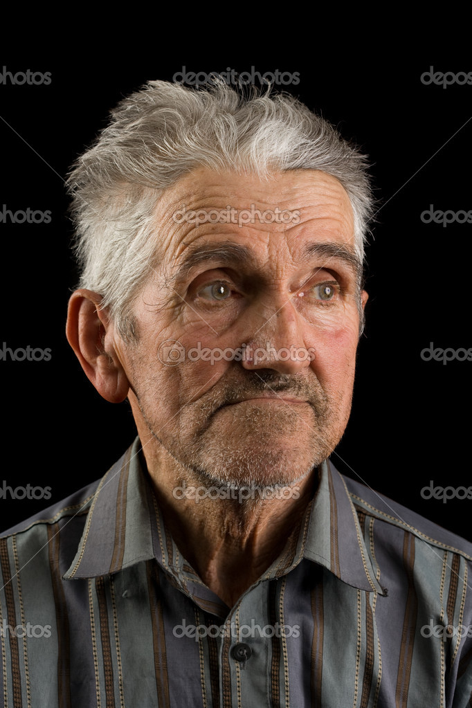 Portrait of an old man isolated on black  Stock Photo #2246228