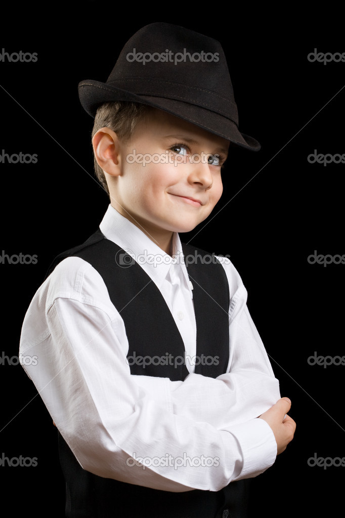 Portrait of a gorgeous little boy posing with hat, isolated on black — Stock Photo #2246419