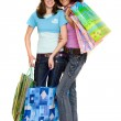 Young women shopping, isolated on white — Stock Photo