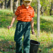 Cute kid with a bucket — Stock Photo #2250047