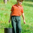 Cute kid with a bucket — Stock Photo #2250053