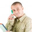 Young casual businessman writing — Stock Photo