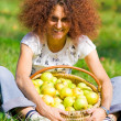 Pretty lady with a basket of apples — Stock Photo #2250289