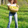 Pretty lady with a basket of apples — Stock Photo #2250343