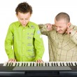 Kid playing piano badly — Stok fotoğraf