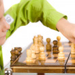 Child playing chess - Stock Photo