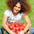 Woman with basket full of apples — Stock Photo #2250694