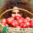 Woman with basket full of apples - Foto Stock