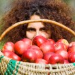 Woman with basket full of apples — Stock Photo