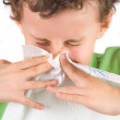 Child wiping his nose — Stock Photo